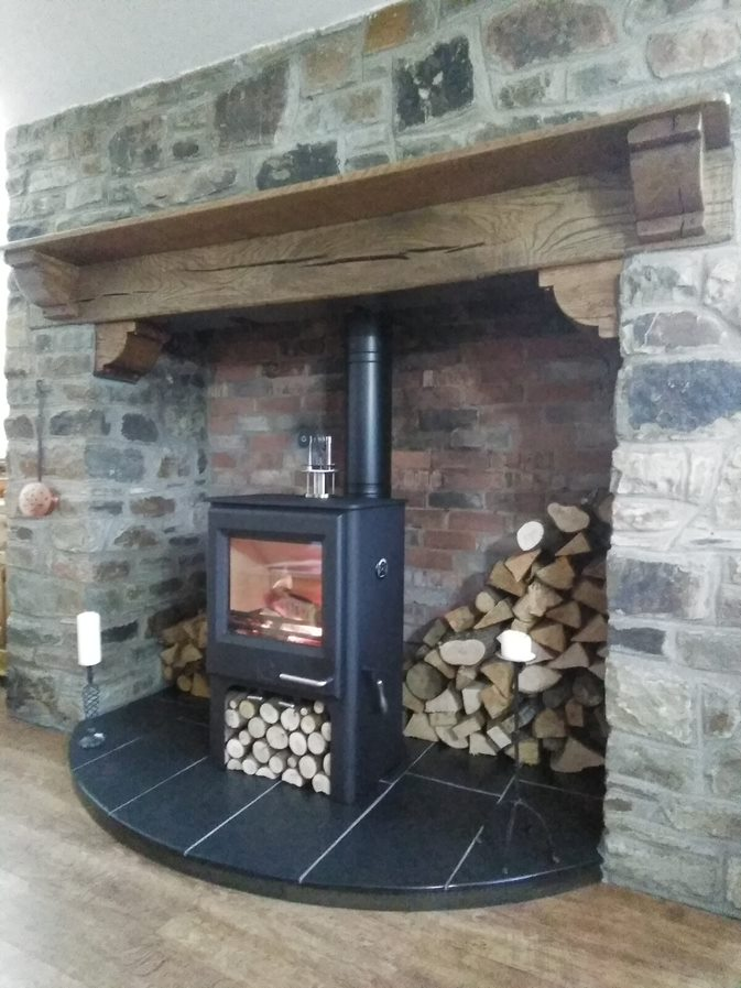 Wood Burner in Stone Fireplace